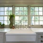 This kitchen blends with its surroundings through architectural cabinetry, countertop, daylighting, home, interior design, kitchen, room, sash window, window, window covering, gray