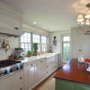 This kitchen blends with its surroundings through architectural cabinetry, ceiling, countertop, cuisine classique, home, interior design, kitchen, property, real estate, room, gray