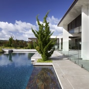 Contemporary outdoor area architecture, condominium, estate, home, house, property, real estate, reflecting pool, reflection, residential area, sky, swimming pool, villa, water, blue, gray