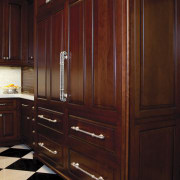 In this kitchen remodel, low-set drawers contain pots cabinetry, chest of drawers, closet, countertop, cupboard, drawer, furniture, hardwood, kitchen, room, wardrobe, wood, wood stain, red