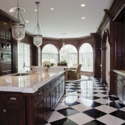 A large addition has increased the size of ceiling, countertop, estate, floor, flooring, home, interior design, kitchen, room, gray, black