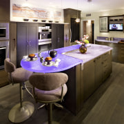 Glass benchtops illuminated with violet lighting ensure this countertop, interior design, kitchen, room, brown