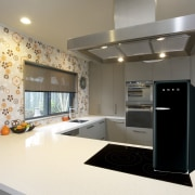 This new kitchen designed by Colleen Holder features countertop, home appliance, interior design, kitchen, gray, white