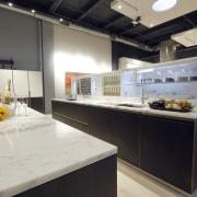 Cinetica cabinetry line, designed by Yaarit Sharoni of countertop, interior design, kitchen, gray, black