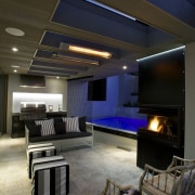 A limited palette of materials was used in ceiling, daylighting, home, interior design, lighting, living room, lobby, brown