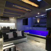 A limited palette of materials was used in ceiling, interior design, lighting, room, black