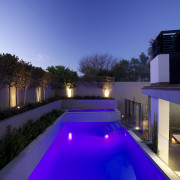 Landscape designer Fiona Kelly converted a walkway into architecture, estate, home, house, landscape lighting, leisure, light, lighting, property, real estate, reflection, residential area, sky, swimming pool, villa, water, blue