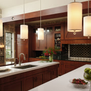 Strong lines and shallow door panels give the cabinetry, countertop, cuisine classique, interior design, kitchen, red, white