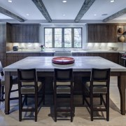 In this kitchen remodel by Doug Durbin, the countertop, dining room, floor, flooring, interior design, kitchen, room, table, gray, black, teal