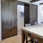 In this kitchen remodel by Doug Durbin, the ceiling, floor, flooring, furniture, interior design, wall, wood, wood flooring, gray