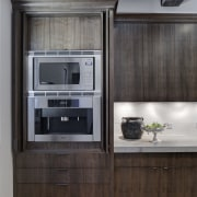 In this kitchen remodel by Doug Durbin, the cabinetry, countertop, cuisine classique, home appliance, interior design, kitchen, kitchen appliance, major appliance, refrigerator, black, gray