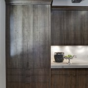In this kitchen remodel by Doug Durbin, the cabinetry, furniture, interior design, wardrobe, gray, black