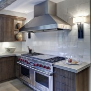In this kitchen remodel by Doug Durbin, the cabinetry, countertop, cuisine classique, home appliance, interior design, kitchen, kitchen appliance, kitchen stove, gray