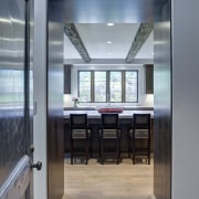 In this kitchen remodel by Doug Durbin, the daylighting, floor, interior design, gray