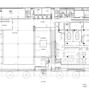 A multifaceted facade behind the reception desk of architecture, area, black and white, design, drawing, floor plan, line, plan, product design, technical drawing, white