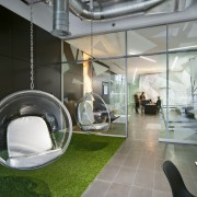A multifaceted facade behind the reception desk of interior design, product design, gray