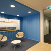 Bold, bright and with several surprise elements, the ceiling, interior design, lobby, office, real estate, teal