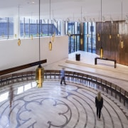 Visitors take a meditative stroll around the labyrinth floor, flooring, leisure centre, tourist attraction, gray