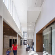 The commons is the key circulation area linking architecture, building, ceiling, daylighting, interior design, lobby, gray, white