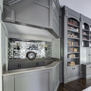 Bar and bookcase in modern urban interior - countertop, home appliance, kitchen, gray