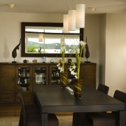 In this kitchen remodel, the designer painted the dining room, furniture, interior design, room, table, brown, black