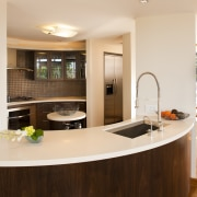 A new opening was created between the blade cabinetry, countertop, interior design, kitchen, real estate, room, white, brown