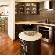 Most countertops are 36in high in this kitchen, cabinetry, countertop, cuisine classique, floor, flooring, furniture, hardwood, interior design, kitchen, room, wood, wood flooring, orange, brown