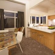 Toni Roberts kitchen with Fisher & Paykel appliances. countertop, floor, flooring, interior design, kitchen, real estate, room, suite, orange, brown