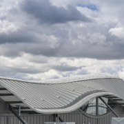 The curvaceous roof is in Rheinzink titanium zinc architecture, building, cloud, daylighting, daytime, facade, house, meteorological phenomenon, outdoor structure, roof, sky, structure, gray
