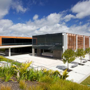 The clean-lined architecure of the facility is matched architecture, corporate headquarters, facade, house, real estate, residential area, sky, gray