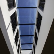 The clean-lined architecure of the facility is matched angle, architecture, building, daylighting, glass, line, window, black, gray