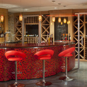 This basement entertaining area designed by LDA Architects. bar, furniture, interior design, liquor store, restaurant, table, wine cellar, red, brown