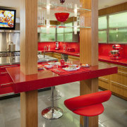 Bright red accents enliven this entertaining area in countertop, furniture, interior design, kitchen, table, brown
