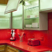 Lift-up doors on the overhead cabinets in this architecture, cabinetry, ceiling, countertop, glass, interior design, kitchen, lighting, room, under cabinet lighting, green, red, brown