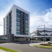 The Crossing at Highbrook Business Park was constructed apartment, architecture, building, commercial building, condominium, corporate headquarters, elevation, facade, headquarters, metropolitan area, mixed use, neighbourhood, real estate, residential area, sky, white