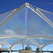 The soaring roof of the Kauwi Interpretive Centre arch, architecture, daytime, fixed link, landmark, roof, sky, structure, teal, blue