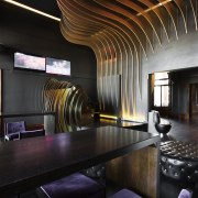 To achieve the right mood, feature walls and ceiling, interior design, lobby, restaurant, table, black