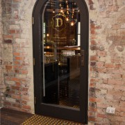 Bar restoration with Caroma and Fowler fittings - arch, brick, door, glass, window, wine cellar, red, orange