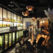 The bar has undergone a complete transformation , interior design, black