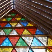 Resene paints feature throughout the new Christchurch Transitional daylighting, glass, material, stained glass, symmetry, window, brown