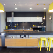 Citrus lemon accents contrast dark grey walls and countertop, interior design, kitchen, gray, black