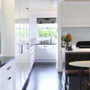 In this design, the diamond-pattern motif on the countertop, cuisine classique, floor, home, interior design, kitchen, real estate, room, window, white
