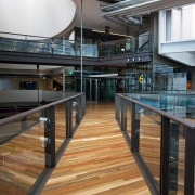 Pre-finished spotted gum floor by Hardwood Technology apartment, architecture, building, daylighting, floor, glass, handrail, lobby, black