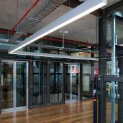 Zig-zag lighting by Aesthetics LIghting was custom designed building, glass, structure, black, gray