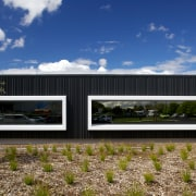 An architectural metal facade by Metal Design Solutions architecture, facade, house, real estate, shed, sky, blue