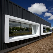 An architectural metal facade by Metal Design Solutions architecture, facade, home, house, sky, window, black