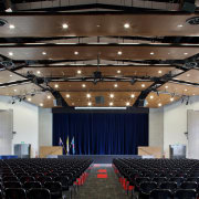 The building framework, protruding stage and attached canopy auditorium, ceiling, convention center, function hall, performing arts center, theatre, black, gray