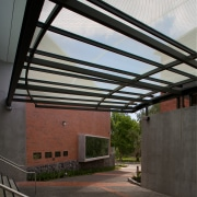 The building framework, protruding stage and attached canopy architecture, daylighting, roof, structure, black, gray