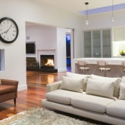 Contemporary new home.  Timber floors bring a floor, furniture, home, interior design, living room, property, real estate, room, gray