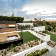 Tiered landscaping adds visual depth and interest to architecture, courtyard, estate, home, house, property, real estate, residential area, roof, villa, yard, white